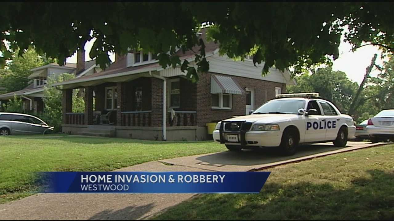 "One man is in custody and another is on the run after a home invasion robbery in Westwood. The suspect still on the loose is being called ""very armed and very dangerous."""