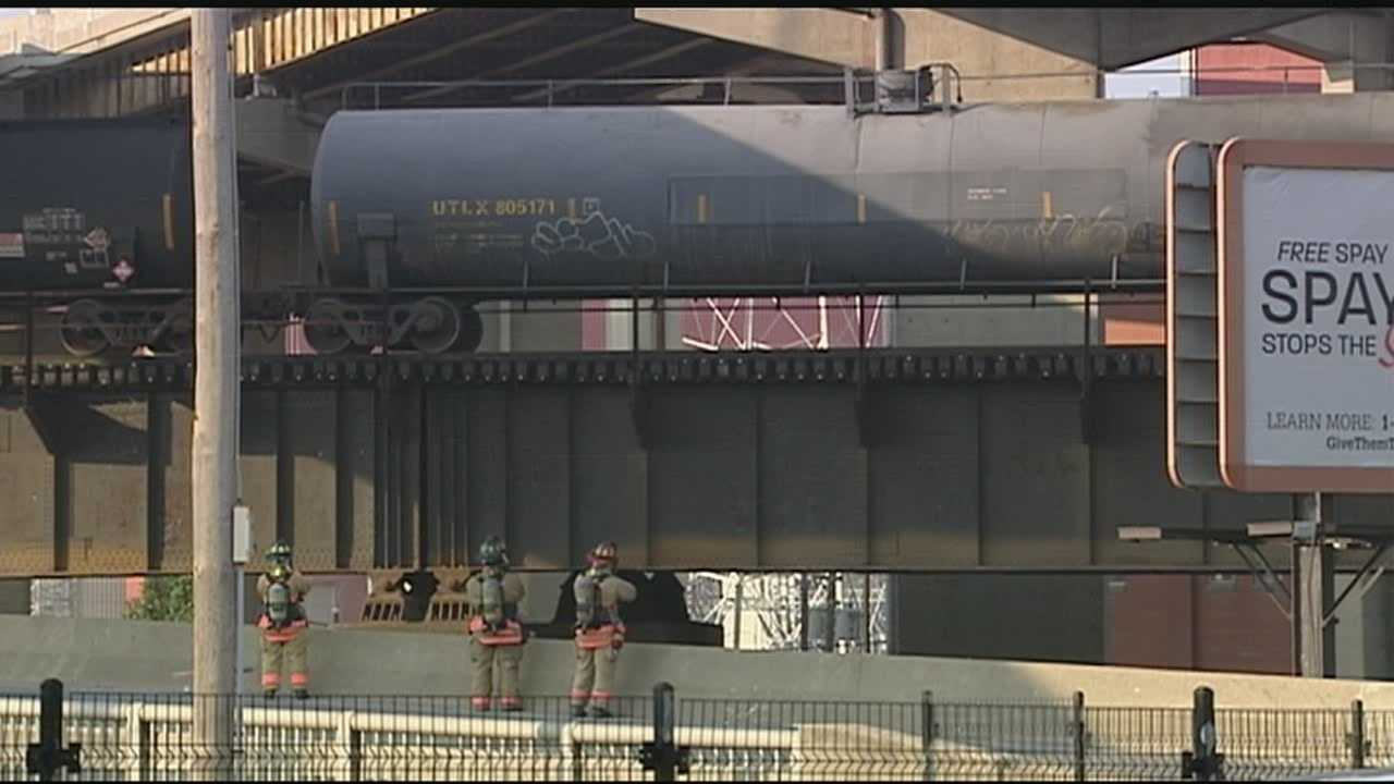 A railcar spewing a vapor cloud caused a busy bridge into downtown Cincinnati to be closed Thursday morning as firefighters worked to assess the danger.