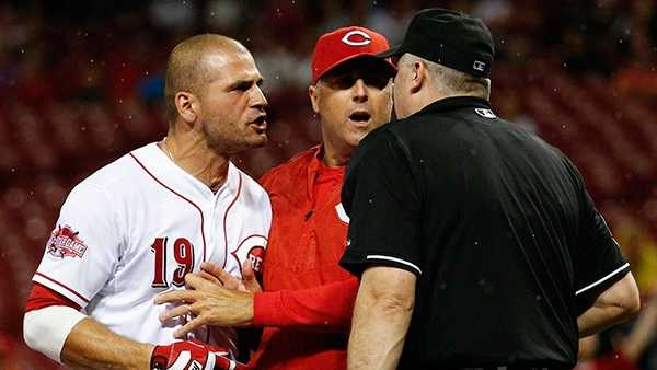 Cincinnati Reds' Joey Votto (19) is restrained by Bryan Price as he argues with umpire Bill Welke after being thrown out of the game for arguing balls and strikes in the eighth inning of a baseball game against the Pittsburgh Pirates, Wednesday, Sept. 9, 2015, in Cincinnati. Price was also ejected. (AP Photo/John Minchillo)
