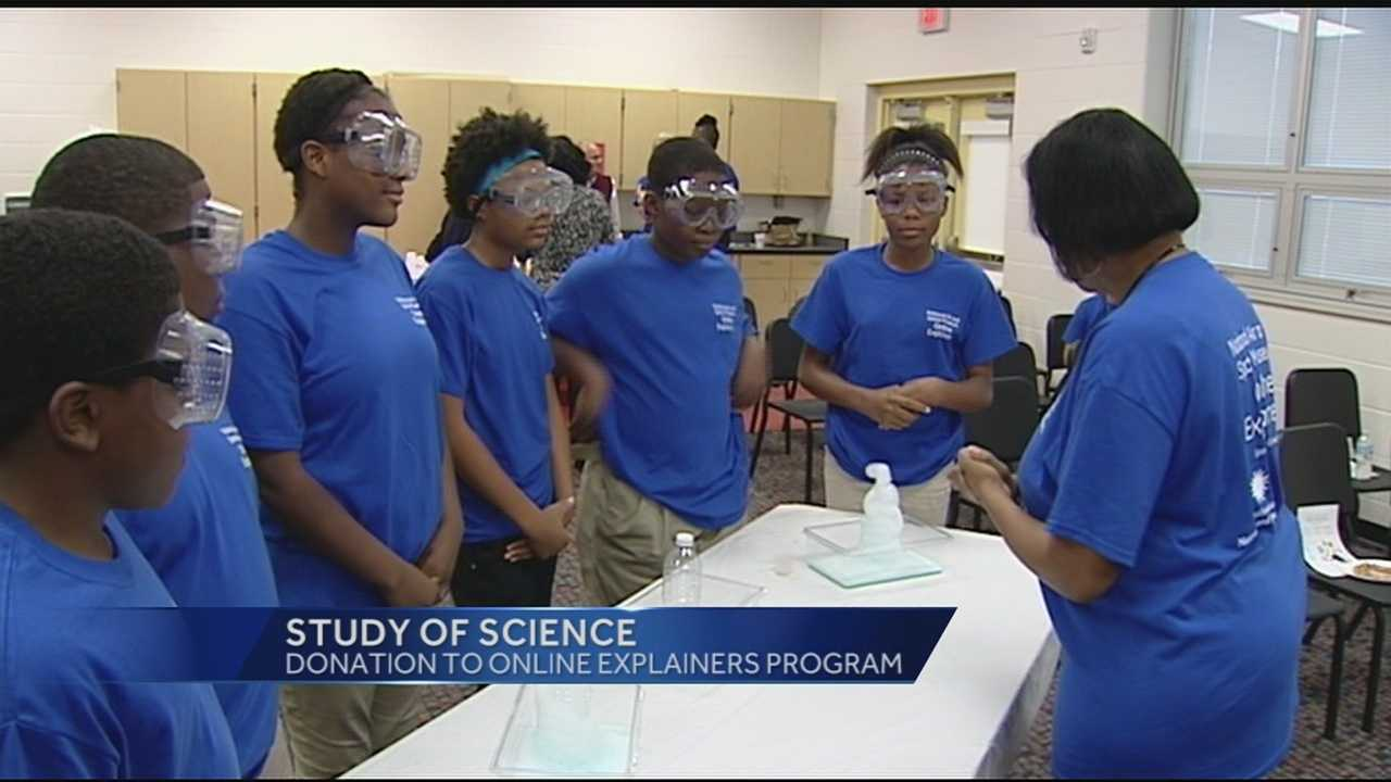 Sixth-grade students from Evanston Academy worked with chemicals Tuesday morning to generate a safe cleaning solution for spacesuits.