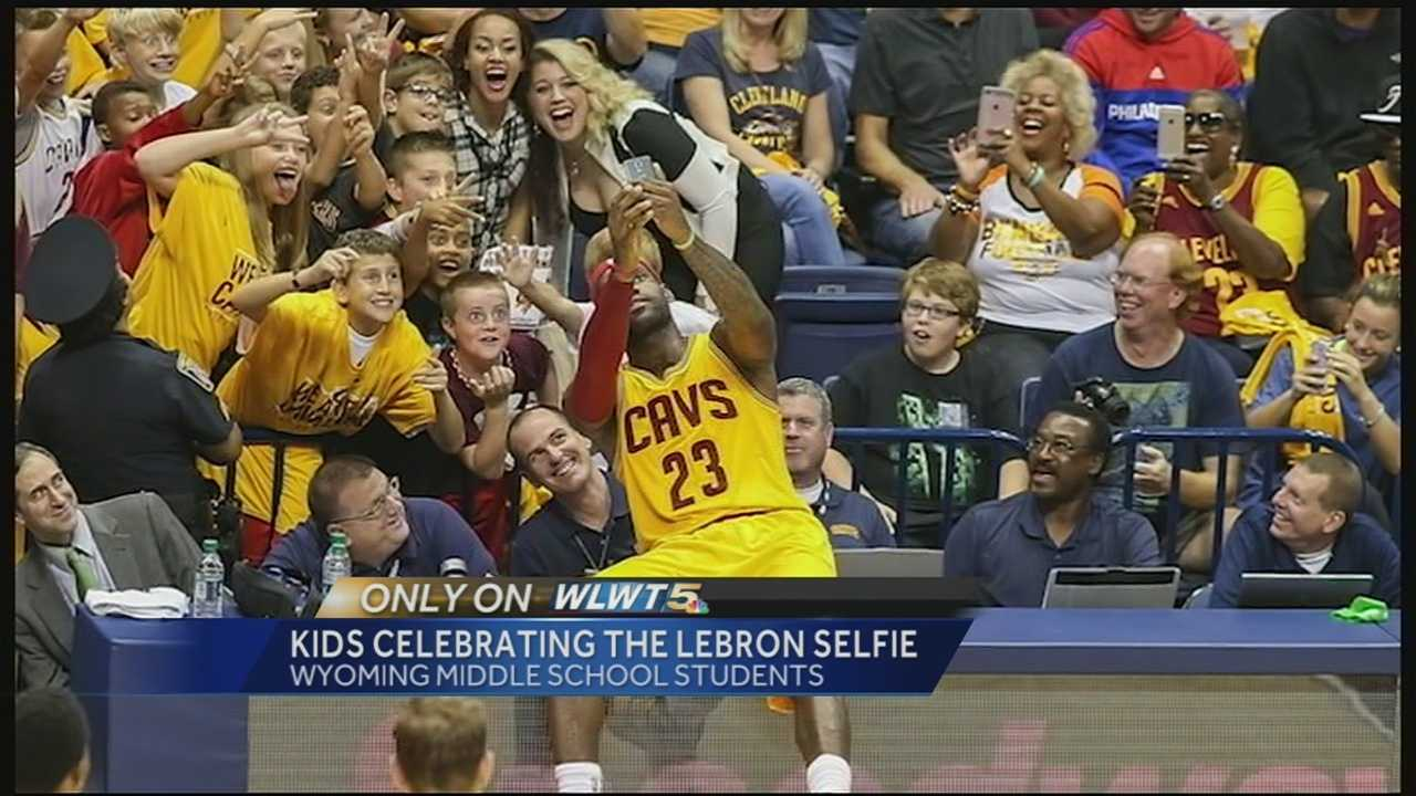During an exhibition game at Xavier's Cintas Center, NBA superstar LeBron James took a selfie with fans, including several students from Wyoming Middle School.