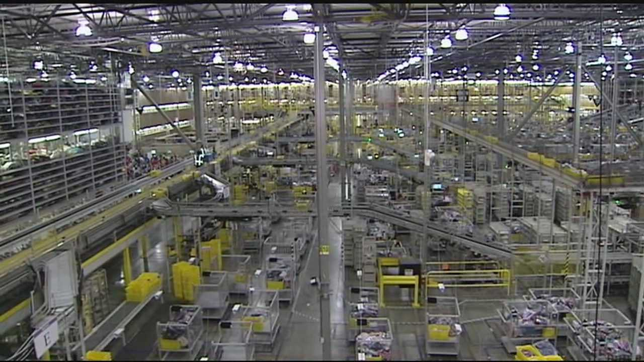While an estimated 120 million Americans will log in to point and click their way through their holiday shopping this Cyber Monday, a lot of their items will wind their way through the over 2-million square feet of the Amazon distribution center in Hebron.