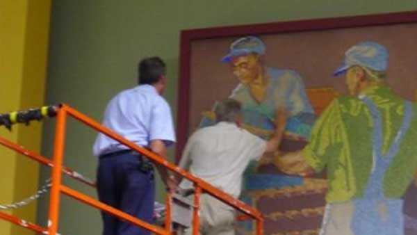 Art Conservators examining the murals at CVG in 2013, Via the Cincinnati Preservation Association