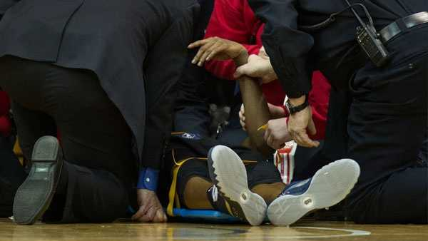 Xavier guard Edmond Sumner was removed from the court on a stretcher Thursday as No. 6 Xavier fell to No. 16 Villanova. (AP image)