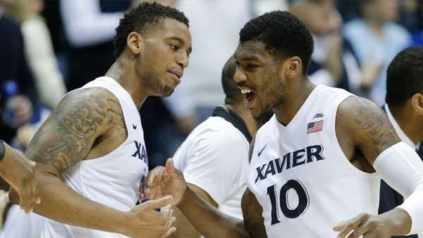 Xavier's Remy Abell (10) celebrates with Trevon Bluiett, left, in the second half of an NCAA college basketball game against Butler, Saturday, Jan. 2, 2016, in Cincinnati. Xavier won 88-69. (AP Photo/John Minchillo)
