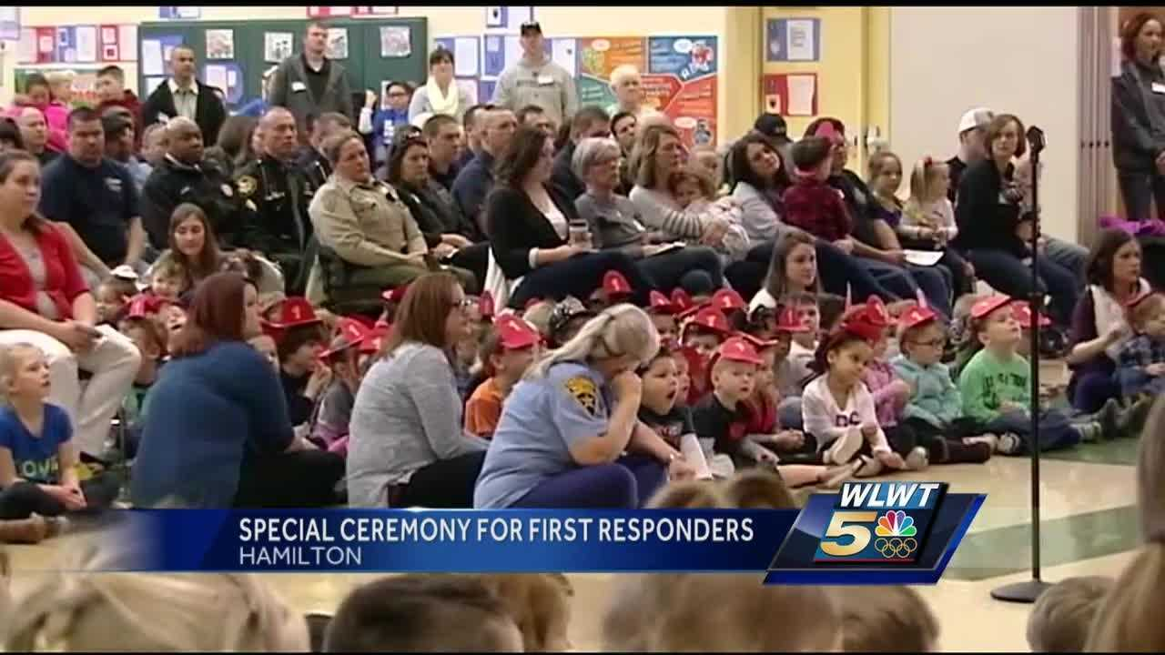 The event at a Hamilton school included honoring a city firefighter who died in the line of duty.
