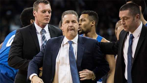 Kentucky head coach John Calipari leaves the court after receiving two technical fouls and getting ejected during the first half of an NCAA college basketball game against South Carolina Saturday, Feb. 13, 2016, in Columbia, S.C. Kentucky defeated South Carolina 89-62. (AP Photo/Sean Rayford)