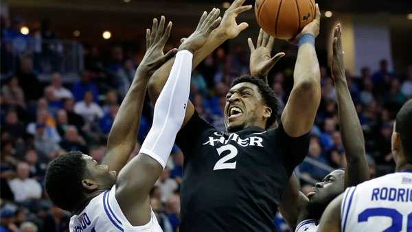 Xavier forward James Farr (2) shoots as Seton Hall forward Angel Delgado (31) tries to block his path during the first half of an NCAA college basketball game Sunday, Feb. 28, 2016, in Newark, N.J. (AP Photo/Mel Evans)