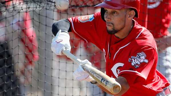 Cincinnati Reds' Billy Hamilton tries to bunt during a spring training baseball workout Thursday, Feb. 25, 2016, in Goodyear, Ariz. (AP Photo/Ross D. Franklin)