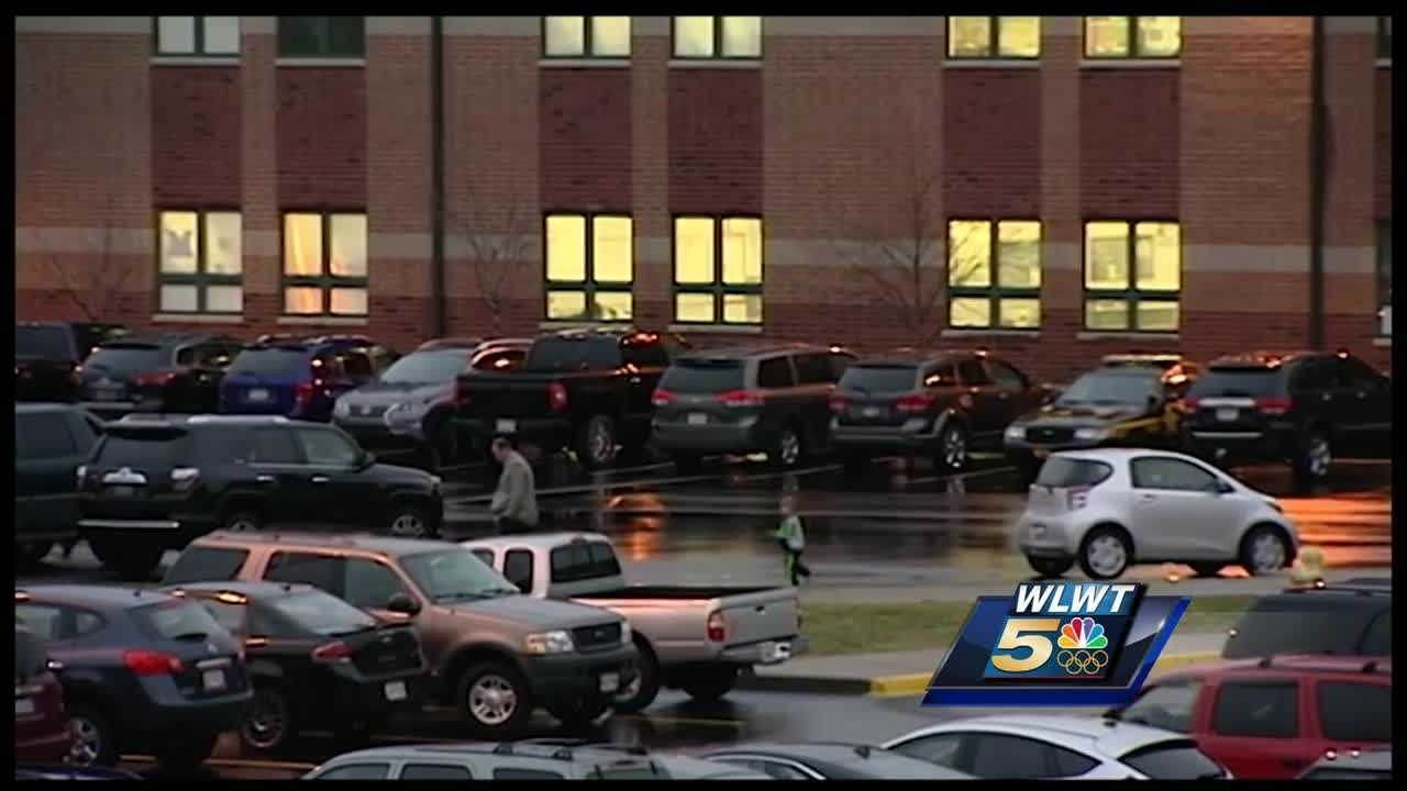 Instead of a Tuesday night basketball game or PTA meeting, the parking lot of Madison Junior/Senior High School was full for the school's first ever walk-through after Monday's shooting.