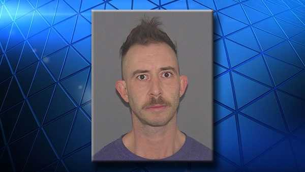 Justin Kuss, 38, is accused of threatening a woman with an ax.