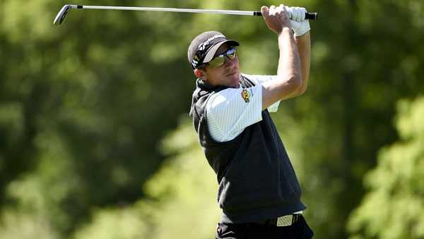 Jim Herman hits his second shot on the 15th hole during the third round of the Houston Open golf tournament, Saturday, April 2, 2016, in Humble, Texas. (AP Photo/Eric Christian Smith)