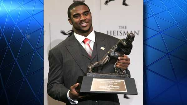 Troy Smith, as Ohio State quarterback, holds the Heisman Trophy