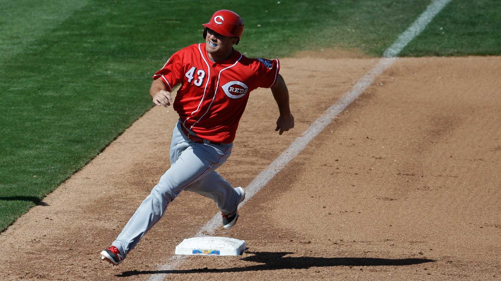 Cincinnati Reds' Scott Schebler in action during a spring training baseball game against the Seattle Mariners on Sunday, March 13, 2016, in Peoria, Ariz.