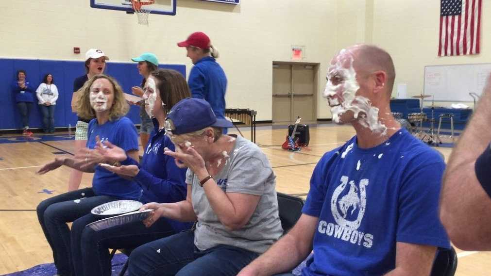 Administrators take pies to the face after students raise more than $1,200 to fight childhood cancer.