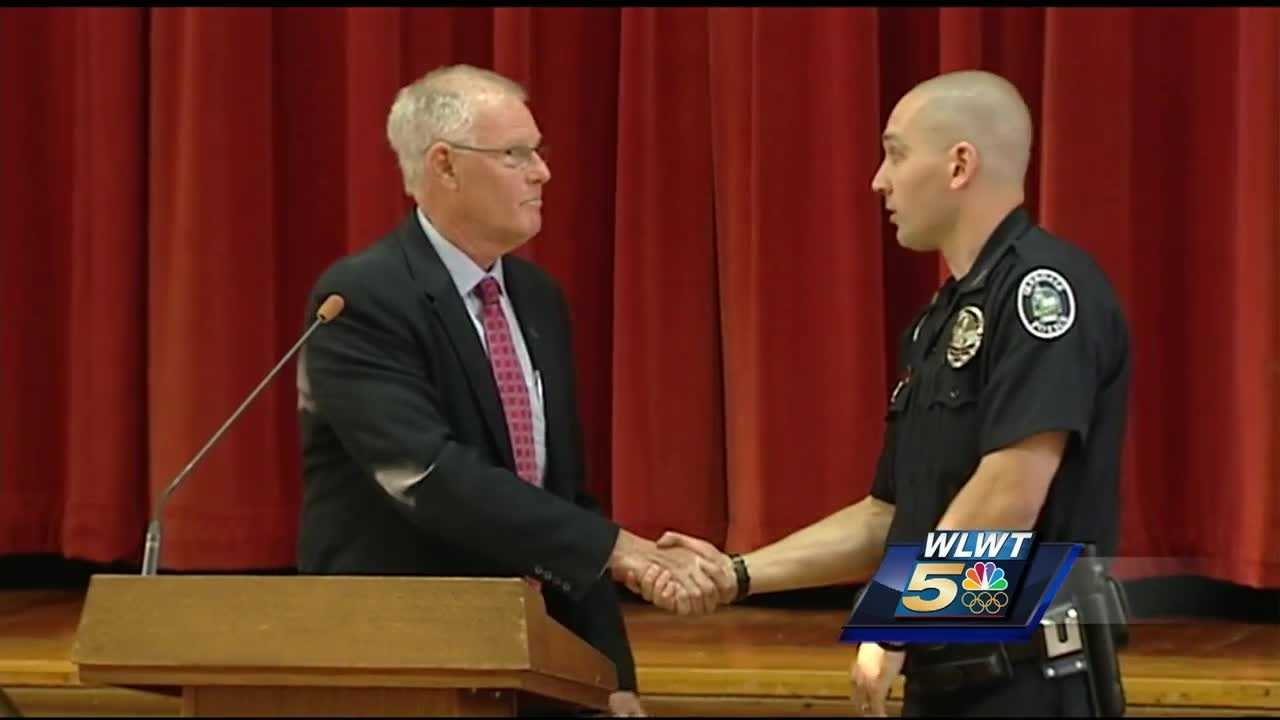 A police officer who shot and wounded a man during a confrontation on I-75 was honored by the village he serves.
