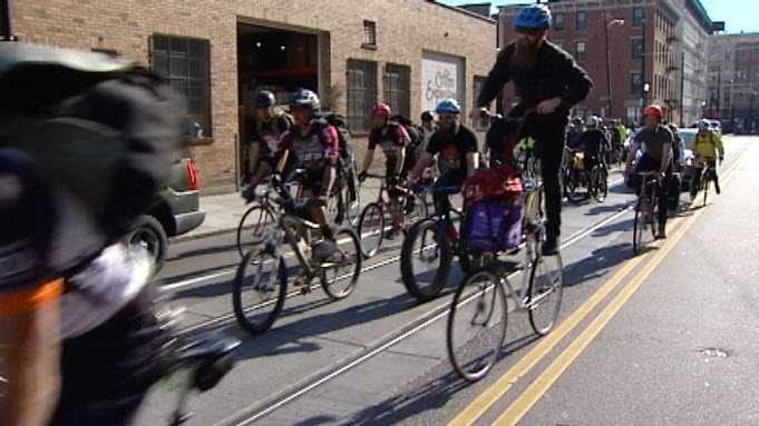 A group of volunteers delivered books to a Cincinnati school on their bicycles Friday.