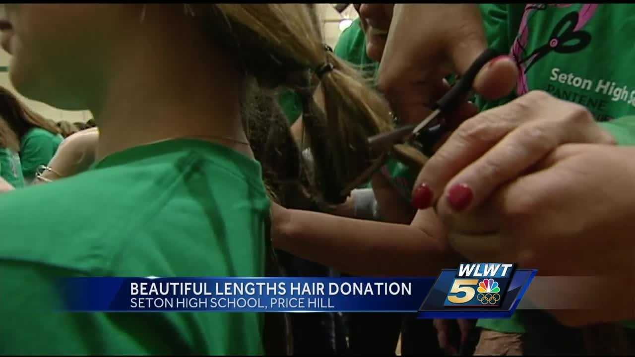 Hundreds gather at Seton High School in Price Hill on Monday morning to get a haircut benefiting a good cause.