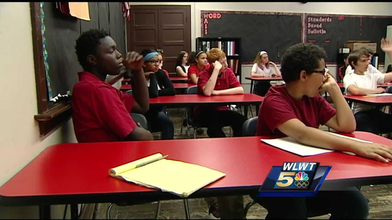 Holmes Middle School students read seven novels as part of a teacher's literacy challenge. Students said the challenge has made many of them lifelong readers.
