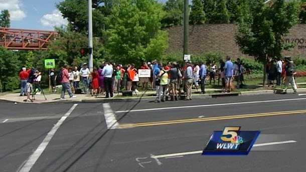 Community members gathered outside the Cincinnati Zoo May 30, 2016 after a gorilla was shot and killed to protect a boy who had gotten into his habitat.