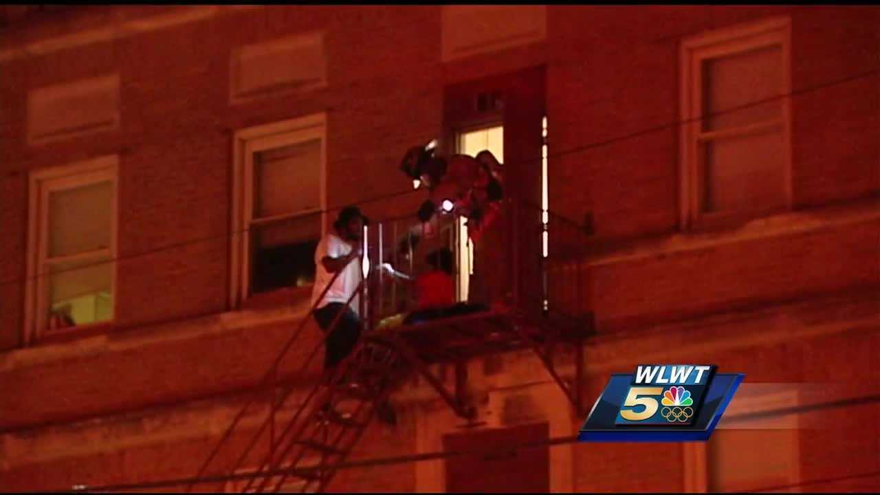 An overnight three-alarm fire displaced nearly two dozen people and sent four to hospitals.
