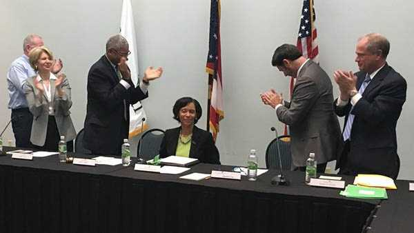 Monica Posey (seated) is congratulated after being named president