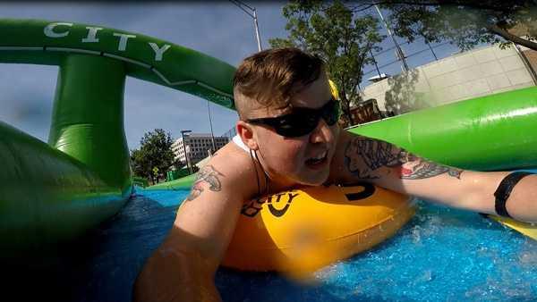Zachary Metz takes a turn on Slide the City in Cincinnati. Slide the City erected a 1,000-foot water slide on Cincinnati's Jefferson Avenue June 18, 2016.