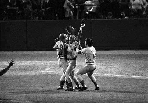 Cincinnati Reds pitcher Will McEnany (37) celebrates his team's World Series championship victory with catcher Johnny Bench and third baseman Pete Rose (14) in Boston, Ma., Oct. 22, 1975. McEnary came in to pitch for the Reds in the ninth inning of game 7. The Reds beat the Red Sox, 4-3.