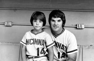 Cincinnati Reds player Pete Rose (14) poses with his son, Pete Rose Jr., at the All-Star game in New York City on July 19, 1977.