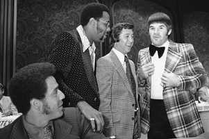 Cincinnati Reds' Pete Rose, right, wore bow tie to luncheon for All-star baseball players in Kansas City, Tuesday, July 24, 1973 and drew admiring attention from other All-Star players, from left&#x3B; Amos Otis of the Kansas City Royals&#x3B; Willie Stargell of the Pittsburgh Pirates and Bobby Murcer, New York Yankees. National League and American League meet Tuesday night in 44th All-Star game.