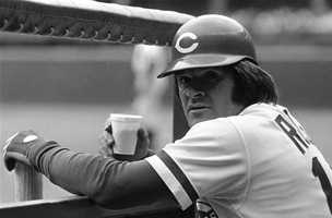 """Cincinnati Reds third baseman Pete Rose, shown relaxing with a cup of coffee while waiting for his turn to bat in the team's last game of the season on Friday, Oct. 20, 1978, trimmed the list of possible teams he might consider in the upcoming free agent draft. Rose named eight teams he would give """"serious consideration,"""" but also did not rule out signing with the Reds"""