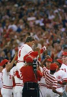 Cincinnati Reds player-manager Pete Rose is congratulated by his teammates after he broke Ty Cobb's hitting record, Sept. 11, 1985.