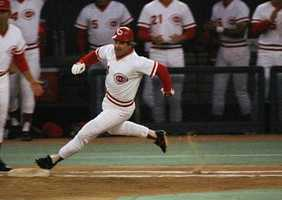 In this Sept. 11, 1985, file photo, Cincinnati Reds' Pete Rose rounds first base after hitting a single to break Ty Cobbs hitting record during a baseball game at Riverfront Stadium, Cincinnati, Ohio. The last player to be banned for life from baseball makes his living these days signing autographs. Rose has some advice for Alex Rodriguez if he wants to avoid the same fate.