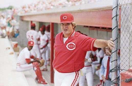 Cincinnati Reds' manager Pete Rose Leans against the dugout before the start of game Wednesday, March 22, 1989, in Plant City, Fla. Rose talked to reporters before the start of the game but refused to comment on the Commissioner's Office investigation.