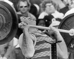 Pete Rose, most valuable player in the National League for the Cincinnati Reds, strains as he fails to make a 200-pound lift, coming in fourth in the Superstars 1974 event at Rotonda, Fla., Feb. 25, 1974.