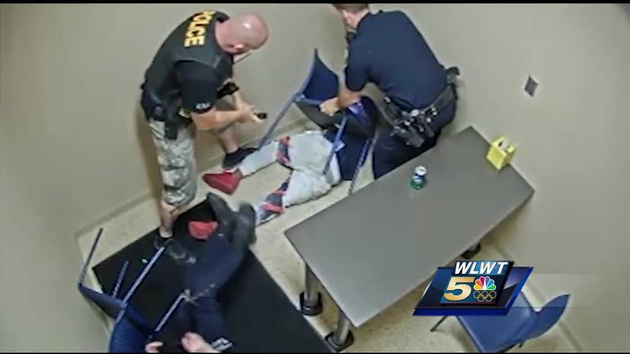 Shocking moments were caught on camera as a Cincinnati Police officer fought off a murder suspect trying to steal his gun.