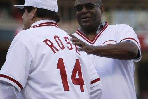 Former Cincinnati Reds player Pete Rose (14) is greeted by teammate Ken Griffey, right, as he is introduced on the field during a ceremony to honor the 1976 World Series champions, before the Reds' baseball game against the San Diego Padres, Friday, June 24, 2016, in Cincinnati. (AP Photo/John Minchillo)
