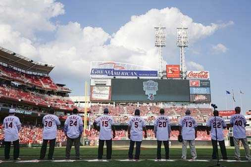 Former Cincinnati Reds, including Pete Rose (14), watch the big screen during a ceremony to honor the 1976 World Series champion team, before the Reds' baseball game against the San Diego Padres, Friday, June 24, 2016, in Cincinnati. (AP Photo/John Minchillo)