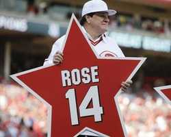 Former Cincinnati Reds player Pete Rose holds his place marker during a ceremony to honor the 1976 World Series champion team, before the Reds' baseball game against the San Diego Padres, Friday, June 24, 2016, in Cincinnati. (AP Photo/John Minchillo)