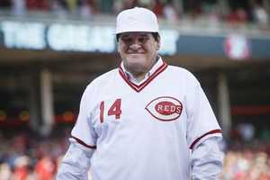 Former Cincinnati Reds player Pete Rose smiles as he is introduced during a ceremony to honor the 1976 World Series champion team, before the Reds' baseball game against the San Diego Padres, Friday, June 24, 2016, in Cincinnati. (AP Photo/John Minchillo)