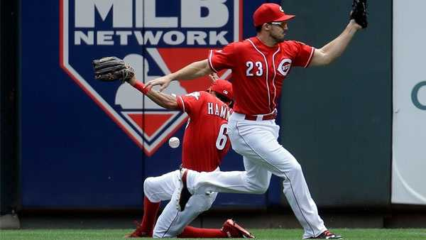 Cincinnati Reds center fielder Billy Hamilton (6) collides with left fielder Adam Duvall (23) as they chase a three-run inside the park home run hit by Chicago Cubs' Anthony Rizzo in the first inning of a baseball game, Wednesday, June 29, 2016, in Cincinnati. (AP Photo/John Minchillo)