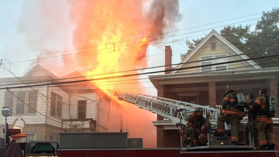 Firefighters battle an apartment fire on Grove Avenue