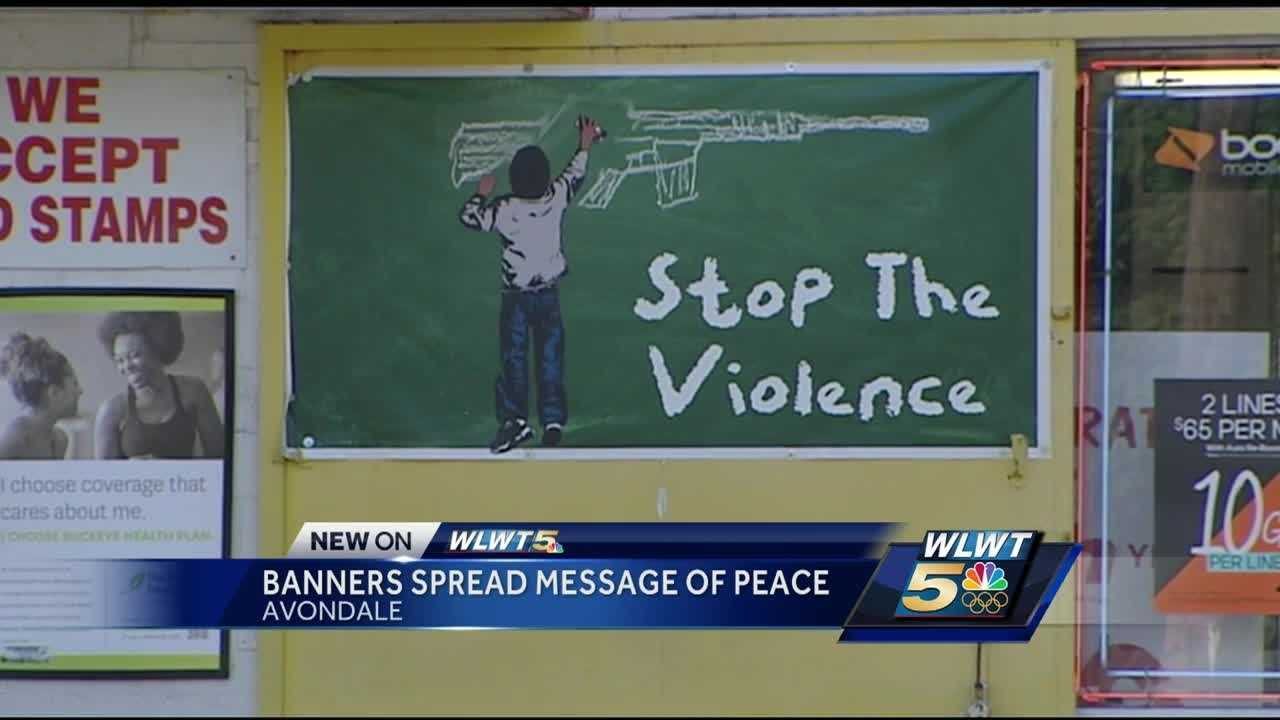 Powerful artwork and banners are popping up along some of Cincinnati's toughest streets.