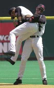 Cincinnati Reds outfielder Ken Griffey, Jr., right, picks up shortstop Barry Larkin while running on the field at the beginning of a game against the Arizona Diamondbacks Saturday, July 22, 2000 in Cincinnati. The Reds were waiting to see if Larkin will approve a trade to the New York Mets.