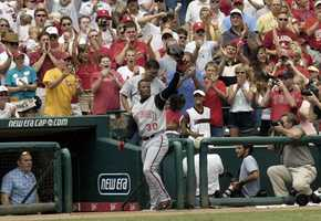 Cincinnati Reds' Ken Griffey Jr. acknowledges the crowd after hitting career home run 500 in the sixth inning against the St. Louis Cardinals Sunday, June 20, 2004, at Busch Stadium in St. Louis.