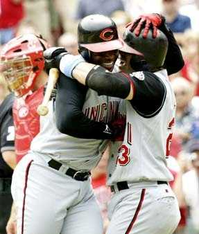 Cincinnati Reds' Ken Griffey Jr. left, and Jason LaRue hug following Griffey Jr's solo home run in the sixth inning off St. Louis Cardinals starting pitcher Matt Morris. Griffey's home run was his 500th of his career and occured on Fathers Day with his father Ken Griffey Sr. and his family in the stands.