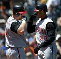 The Cincinnati Reds' Ken Griffey Jr., right, exchanges a nose-touching gesture at home with Adam Dunn following Griffey's solo home run in the third inning off of the San Francisco Giants' Kirk Rueter, Monday, July 4, 2005 in San Francisco.