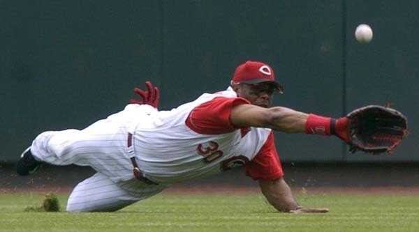 Cincinnati Reds' Ken Griffey Jr. dives for a ball that fell for a basehit by Chicago Cubs' Aramis Ramirez in the first inning, Thursday, July 21, 2005, in Cincinnati.