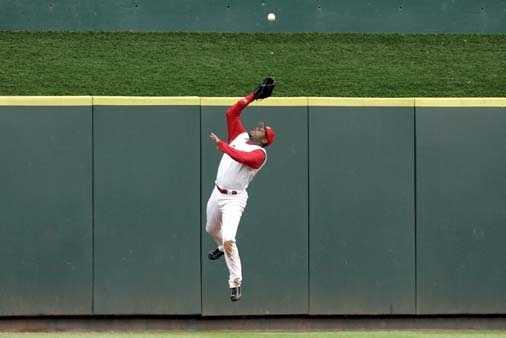 Cincinnati Reds center fielder Ken Griffey Jr. catches a ball hit by Chicago Cubs' Michael Barrett during a baseball game, Saturday, June 10, 2006, in Cincinnati.
