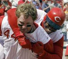 Cincinnati Reds Ken Griffey Jr. jumps on the back of Adam Dunn (44) after Dunn hit a three-run home run off Milwaukee Brewers pitcher Dan Kolb in the 11th inning of a baseball game, Wednesday, June 14, 2006, in Cincinnati. Cincinnati won 3-0.
